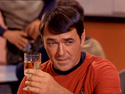 Scotty raises a glass to the Federation
