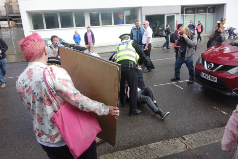 Picture of police arresting LGBTI people protesting against police leading the march at last year's Pride Glasgow
