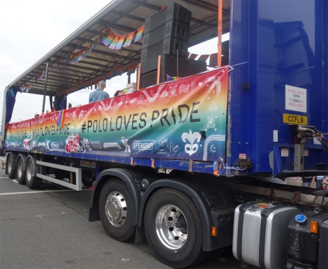 """Picture of float at Pride Glasgow march with """"Polo Loves Pride"""" banner"""