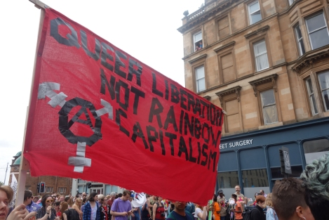 "Picture of ""Queer Liberation Not Rainbow Capitalism"" banner at Pride Glasgow march"